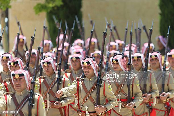 Royal honour guard perform a show as Jordan's King Abdullah II and his wife Queen Rania will welcome Pope Francis upon his arrival at the royal...