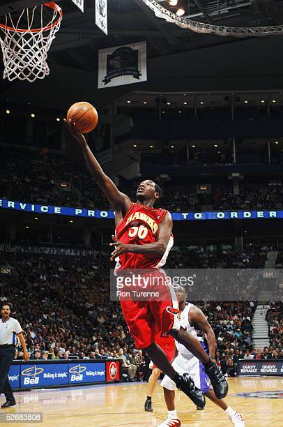 Royal Ivey of the Atlanta Hawks takes the ball to the basket during the game against the Toronto Raptors on April 8 2005 at the Air Canada Centre in...