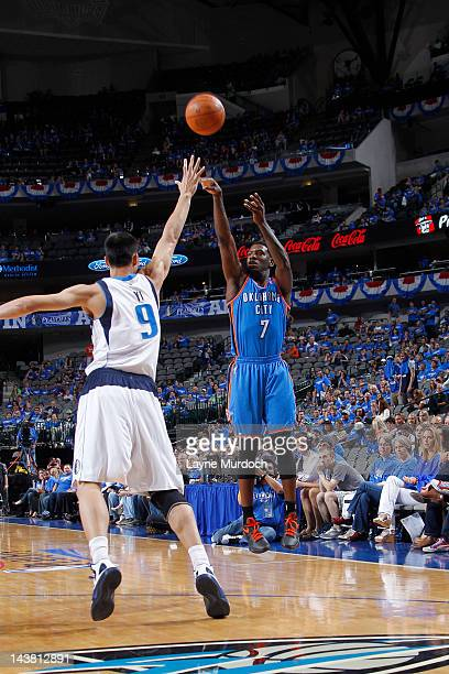 Royal Ivey of the Oklahoma City Thunder shoots against Yi Jianlian of the Dallas Mavericks in Game Three of the Western Conference Quarterfinals...