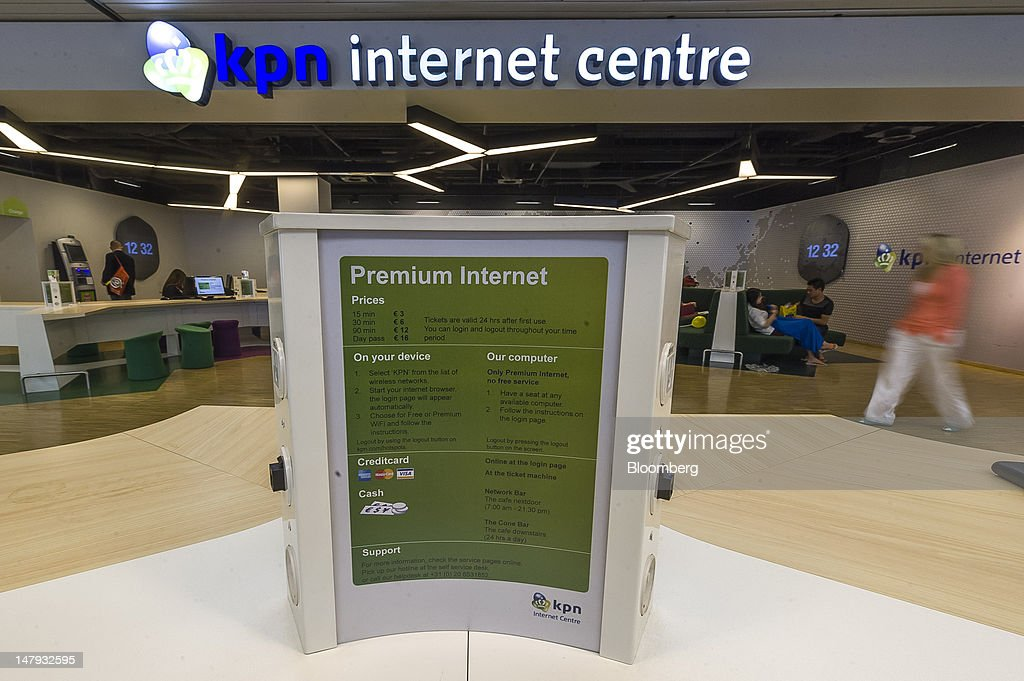 A Royal KPN NV internet centre is seen at Schiphol airport in Amsterdam, Netherlands, on Friday, July 6, 2012. America Movil SAB, Mexican billionaire Carlos Slim's wireless carrier, won the 28 percent stake it sought in Royal KPN NV, increasing its influence in Europe even after opposition from the Dutch operator. Photographer: Jock Fistick/Bloomberg via Getty Images