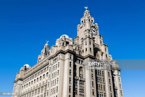 Royal Liver Building seen under a clear blue sky.