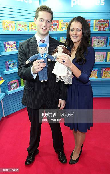 Royal lookalikes Andy Walker and Kate Bevan pose with hand knitted Prince William and Kate Middleton dolls which are part of Galts new Knit a Friend...