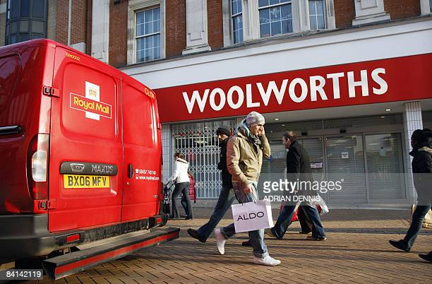 A Royal Mail delivery van stops outside Woolworths' longest trading branch in Croydon in south London on December 30 following its closure The store...