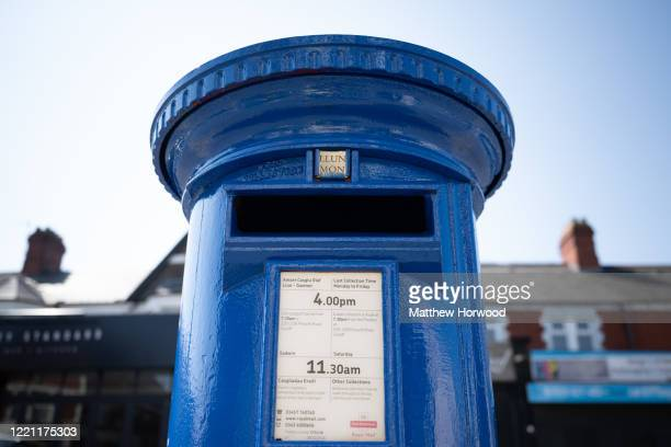 Royal Mail post box painted blue in recognition of the NHS and other key workers on April 26 in Cardiff, Wales. Over 750 people have died with...