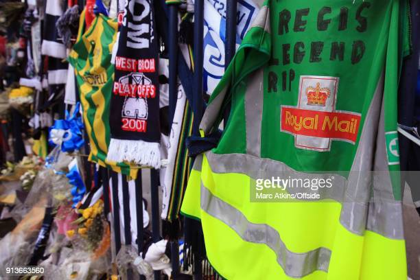 Royal Mail safety vest placed as a tribute to the late Cyrille Regis placed on the Jeff Astle gates prior to the Premier League match between West...