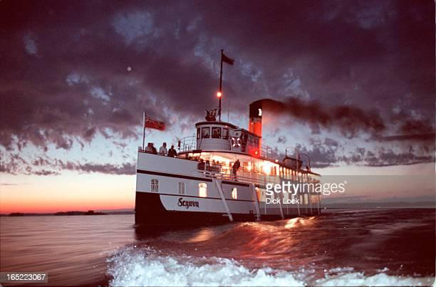 Royal Mail Ship Sagwun returns to Gravenhurst from the sunset dinner cruise on Lake MuskokaEngineer Ben Warren is working the telegraph...