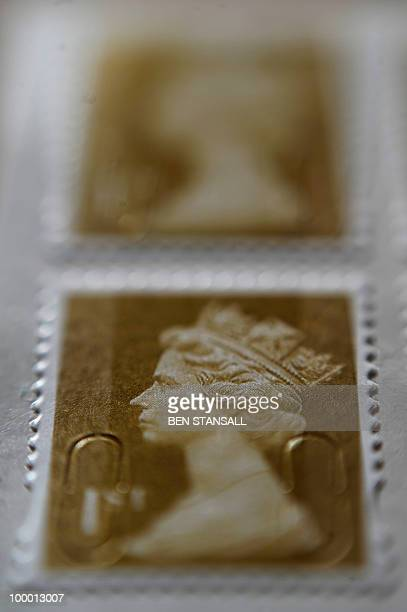 Royal Mail stamps are seen pictured in London on May 20 2010 Britain's new coalition government said on Thursday that it was relaunching plans to...
