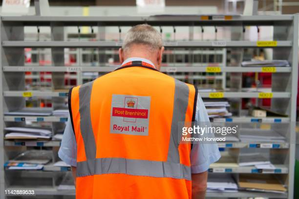 Royal Mail workers at work in a Royal Mail sorting office on February, 2 2019 in Cardiff, United Kingdom.