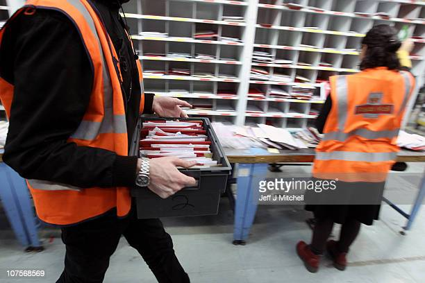 Royal Mail workers handle mail at the St Rollox sorting office on December 14 2010 in Glasgow Scotland This week is traditionally the busiest over...