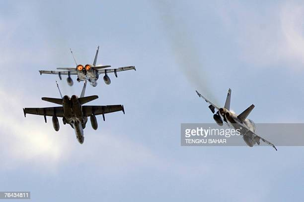Royal Malaysian Air Force F/A18 Hornets break from a diamond formation over the historic Merdeka Square as part of Malaysia's 50th Independence Day...