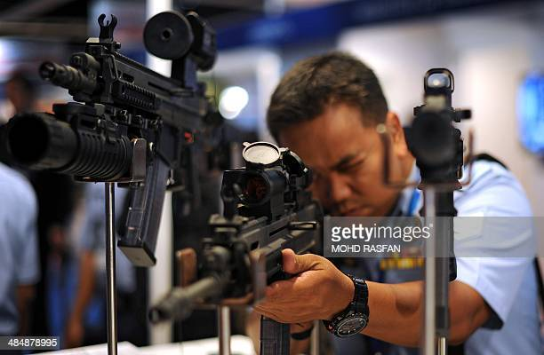A Royal Malaysian Air Force officer tests a CZ 805 Bren A1 556 x 45mm assault rifle during the 14th Defence Services Asia Exhibition and Conference...