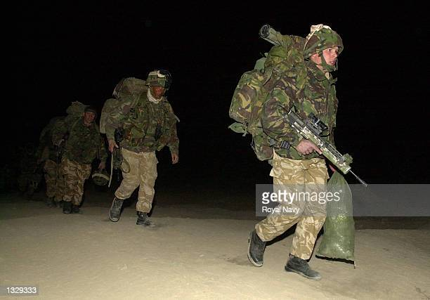 Royal Marine Commandos from Task Force Jacana deploy for Operation Snipe in the Afghan mountains April 30 2002 from the Bagram Air Base in...