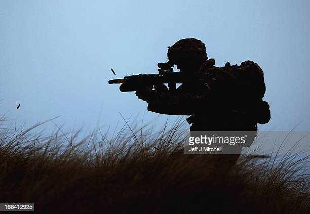 Royal Marine from 42 Commando takes part in an exercise at Barry Buddon simulating an attack on shores of a hostile country on April 12 2013 in...