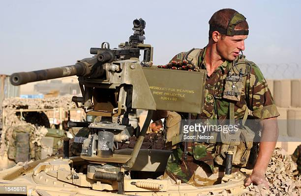 Royal Marine from 45 Commando departs from Bagram Airbase May 27 2002 with a convoy of some 30 vehicles to a new operating area in the search for al...