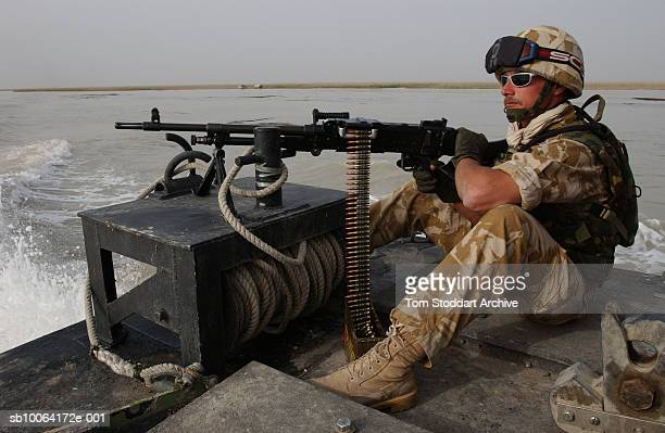 Royal Marine of 539 Assault Squadron pictured with a heavy machine gun while on patrol during the first days of the conflict. 539 ASRM were tasked to...