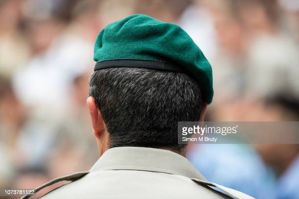 Royal Marine sitting while being photographed before the start of The Wimbledon Lawn Tennis Championship at the All England Lawn Tennis and Croquet...