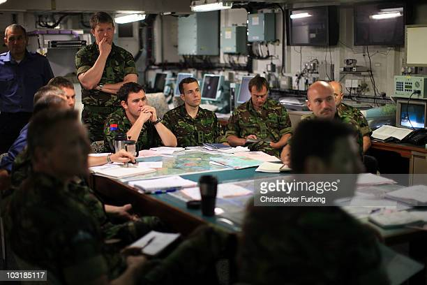 Royal Marines and naval officers attend a briefing on board HMS Ocean during Exercise Auriga on July 14 2010 near Camp Lejeune North Carolina HMS Ark...