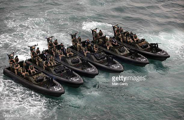 Royal Marines and police leave RFA Mount Bay as they patrol Weymouth bay ahead of the start of the London 2012 Olympics on July 27, 2012 in Portland,...