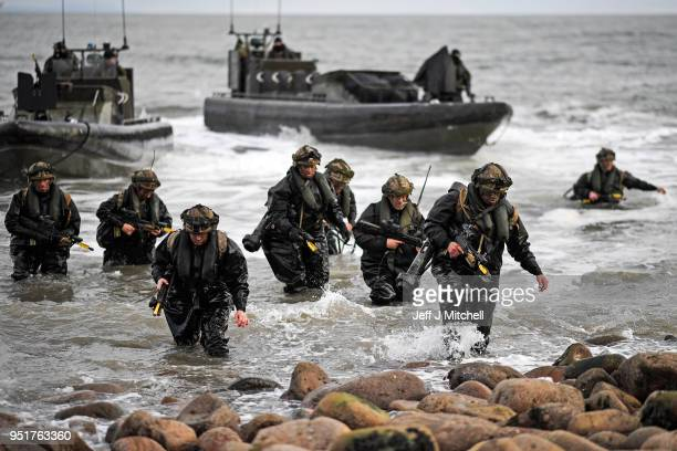 Royal Marines come ashore as they take part in Exercise Joint Warrior on April 26 2018 in DundrennanScotland The exercise is involving some 11600...