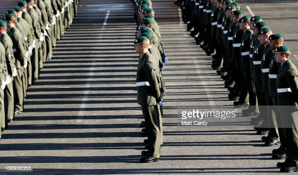 Royal Marines from 40 Commando wait to be presented with their campaign medals following a sixmonth deployment in Sangin Afghanistan at Norton Camp...