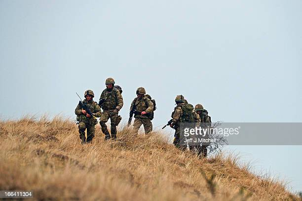 Royal Marines from 42 Commando take part in an exercise at Barry Buddon simulating an attack on shores of a hostile country on April 12 2013 in...