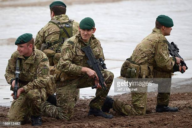 Royal Marines from 42 Commando take part in an exercise at Barry Buddon simulating an attack on shores of a hostile country on April 12, 2013 in...