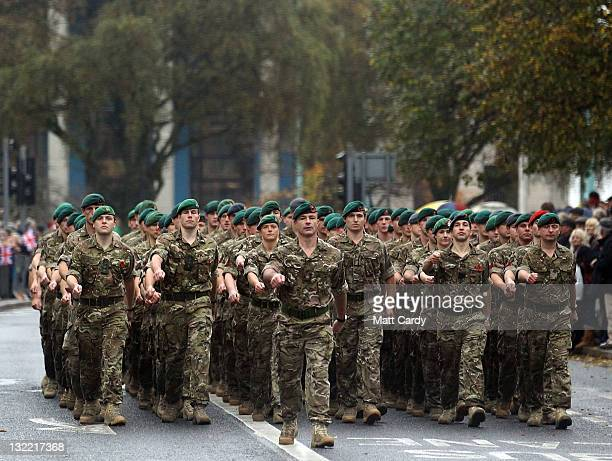 Royal Marines march through Plymouth city centre on November 11 2011 in Plymouth England Thousands of people lined the streets for a Remembrance...