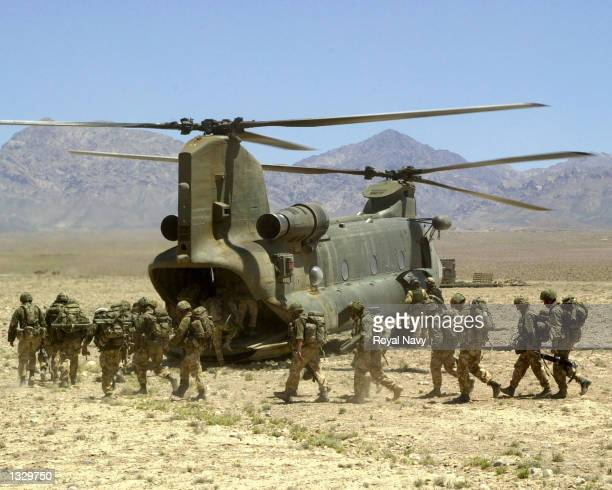 Royal Marines of 45 Commando board a Chinook helicopter of 27 Squadron RAF during Operation Condor May 20 2002 in southeastern Afganistan