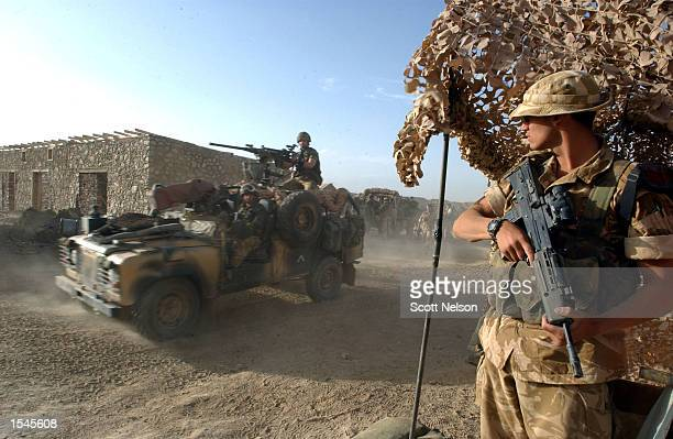 Royal Marines of 45 Commando depart from Bagram Airbase May 27 2002 in a convoy of some 30 vehicles to a new operating area in the search for Al...