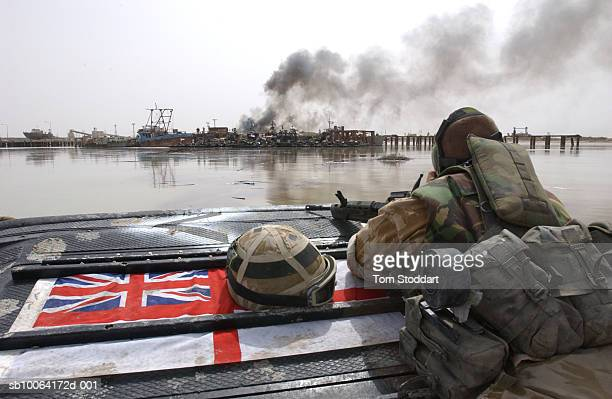 Royal Marines of 539 Assault Squadron carefully approach a burning harbour while on patrol during the first days of the 2003 conflict 539 ASRM were...