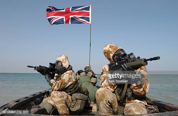 Royal Marines of 539 Assault Squadron in full battle kit pictured beside a Union Jack flag days before the beginning of the Iraq war 2003 539 ASRM...