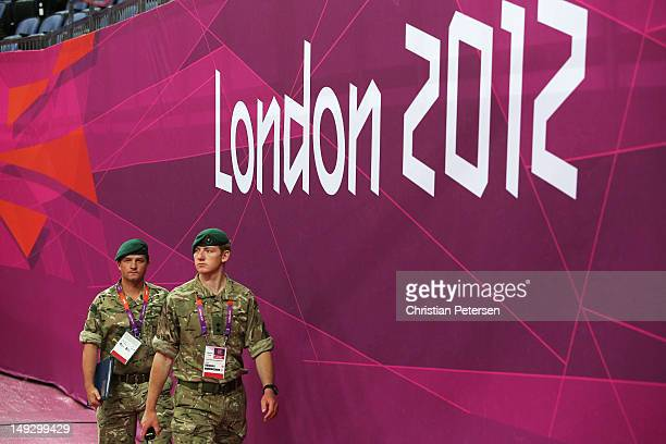 Royal Marines patrol during training sessions for artistic gymnastics ahead of the 2012 Olympic Games at Greenwich Training Academy on July 26 2012...