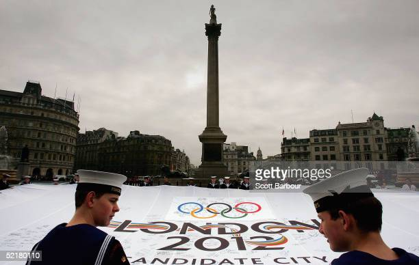 Royal marines sea cadets and sailors hold a giant London 2012 flag aloft in Trafalgar Square on February 11 2005 in London England The London 2012...
