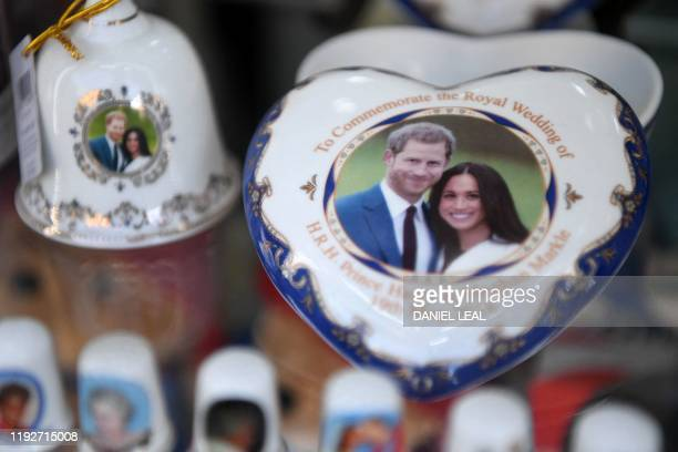 Royal memorabilia featuring Britain's Prince Harry, Duke of Sussex, and Meghan, Duchess of Sussex is displayed in a souvenir shop in Windsor, west of...