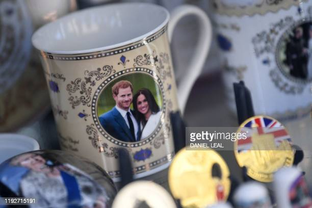 Royal memorabilia featuring Britain's Prince Harry Duke of Sussex and Meghan Duchess of Sussex is displayed in a souvenir shop in Windsor west of...