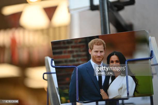 Royal memorabilia featuring Britain's Prince Harry Duke of Sussex and Meghan Duchess of Sussex is displayed for sale in a store near Buckingham...