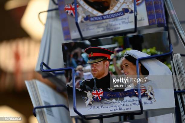 Royal memorabilia featuring Britain's Prince Harry, Duke of Sussex, and Meghan, Duchess of Sussex is displayed for sale in a store near Buckingham...