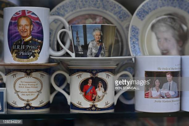 Royal memorabilia is displayed in a shop window in Windsor, west of London, on April 16 following the April 9 death of Britain's Prince Philip, Duke...