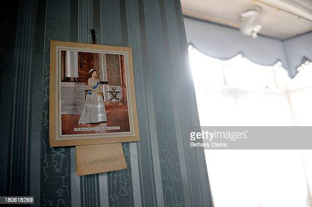 Royal memorabilia is seen on a wall in Pineheath house on September 4 2013 in Harrogate England The untouched 40bedroom house belonged to wealthy...