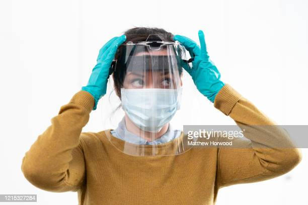 Royal Mint worker Carly O'Donnell wears a medical visor made for NHS workers at the Royal Mint on March 28 2020 in Llantrisant Wales Engineers at The...