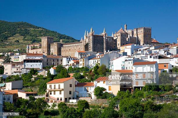 royal monastery of santa maria de guadalupe amidst village of guadalupe. - extremadura stock pictures, royalty-free photos & images