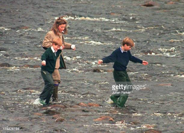 Royal Nanny Tiggy LeggeBourke Prince Williamand Prince Harry walk in the River Gairn near the Balmoral Estate on October 22 1994 in Balmoral Scotland