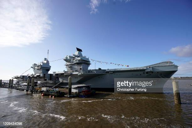 Royal Navy aircraft carrier, HMS Prince of Wales, berths at Liverpool's cruise terminal on February 29, 2020 in Liverpool, England. The Royal Navy's...