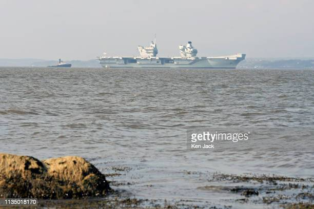 Royal Navy aircraft carrier HMS Queen Elizabeth lies at anchor in the Forth Estuary as weather conditions forced a delay in her entering Rosyth...