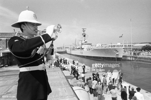 A Royal Navy Bugler plays a final farewell to HMS Hermione the last ship to leave the Royal Naval Dockyard at Chatham Kent This was the end of...