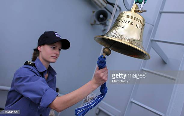 Royal Navy communications rating Sophie Pickford rings RFA Mount Bay's ship bell ahead of it being rung for three minutes as part of the national All...
