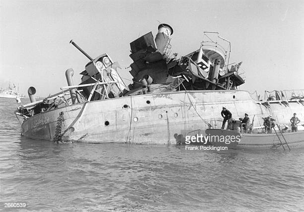 Royal Navy divers begin the task of clearing the Suez Canal of blockships sunk by Nasser's government during the crisis. Original Publication:...