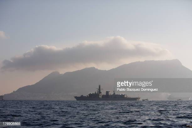 Royal Navy HMS Westminster sails the waters with the Rock of Gibraltar in the background on August 19 2013 in Gibraltar Gibraltar Spanish fishermen...