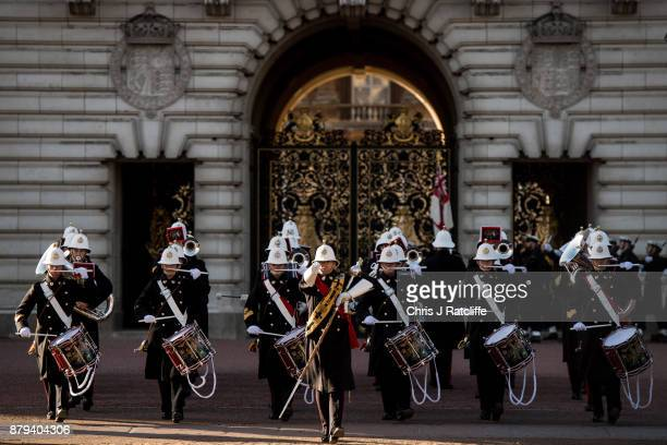 Royal Navy marching band exits the main gate after the British Royal Navy performed their first changing of the guard ceremony at Buckingham Palace...