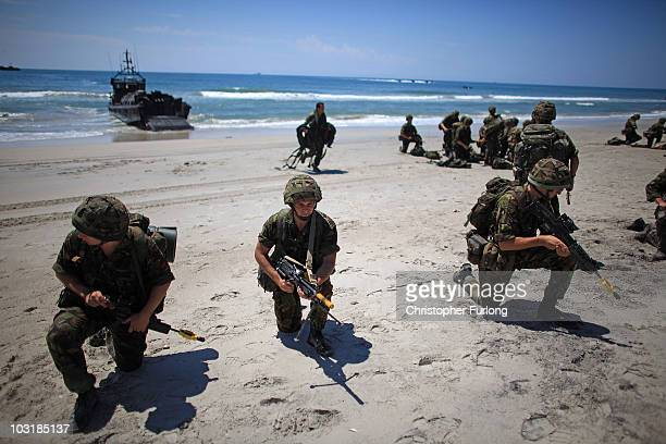 Royal Navy Marine and Army Commandos practice amphibious beach landings on July 14 Camp Lejeune North Carolina HMS Ark Royal the nation's strike...